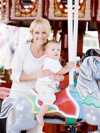 mother and baby on a merry-go-round Stock Photo - Premium Royalty-Free, Code: 640-02951481