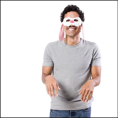 man wearing a bunny mask Stock Photo - Premium Royalty-Free, Code: 640-02951545