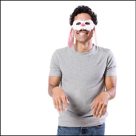 man wearing a bunny mask Stock Photo - Premium Royalty-Free, Code: 640-02951545