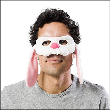 man wearing a bunny mask Stock Photo - Premium Royalty-Free, Code: 640-02951546