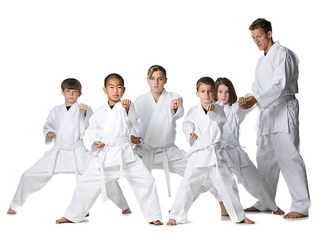 youth practicing martial arts Stock Photo - Premium Royalty-Free, Code: 640-02952075