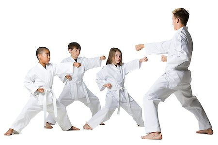 youth practicing martial arts Stock Photo - Premium Royalty-Free, Code: 640-02952076