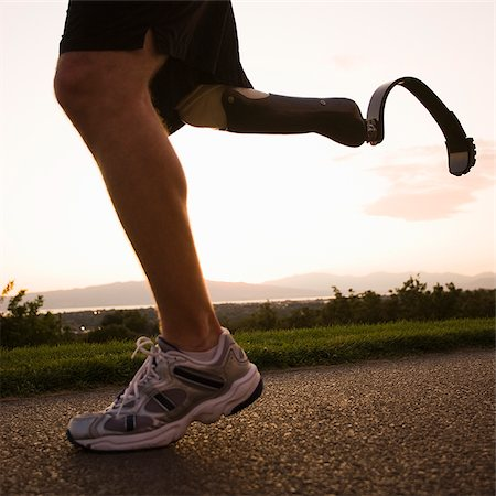 jogger with a right below knee prosthetic running leg Stock Photo - Premium Royalty-Free, Code: 640-02952345