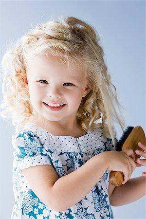 little girl brushing her hair Stock Photo - Premium Royalty-Free, Code: 640-02952430