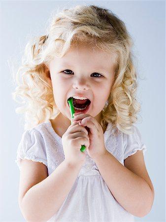 little girl brushing her teeth Stock Photo - Premium Royalty-Free, Code: 640-02952433