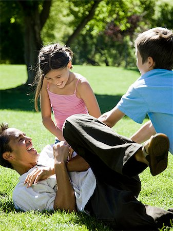 dad in the park with his two kids Stock Photo - Premium Royalty-Free, Code: 640-02952934