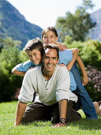 dad in the park with his two kids Stock Photo - Premium Royalty-Free, Code: 640-02952939