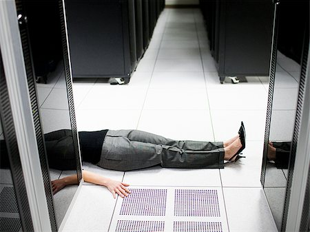 dead female body - woman lying on the floor in a server room Stock Photo - Premium Royalty-Free, Code: 640-02953211