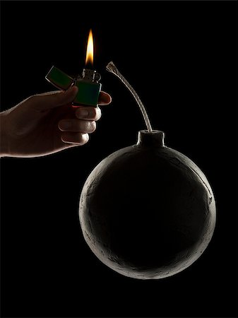 hand lighting the wick on a bomb Stock Photo - Premium Royalty-Free, Code: 640-02953388