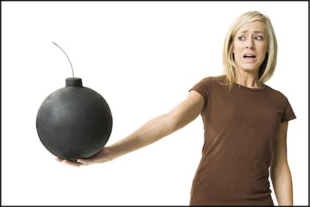 Woman posing and holding bomb Stock Photo - Premium Royalty-Free, Code: 640-03255465