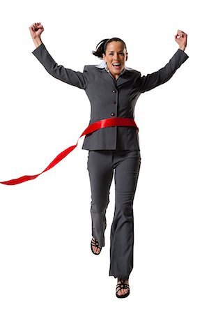 Businesswoman crossing finish line Stock Photo - Premium Royalty-Free, Code: 640-03256148