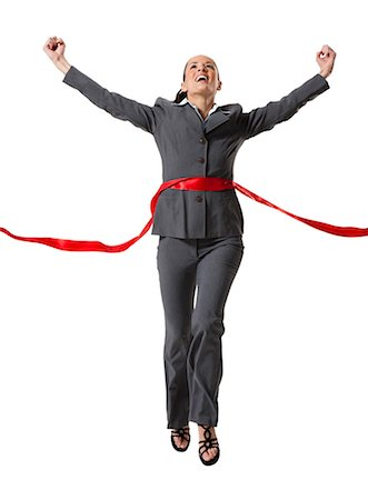 Businesswoman crossing finish line Stock Photo - Premium Royalty-Free, Code: 640-03256149