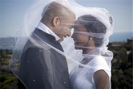 Profile of a newlywed young couple under a veil Stock Photo - Premium Royalty-Free, Code: 640-03256324