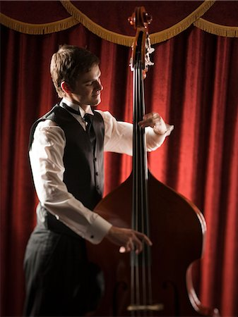 Young man playing double bass Stock Photo - Premium Royalty-Free, Code: 640-03256774
