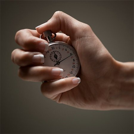 stop watch - Young woman's hand holding stop clock Stock Photo - Premium Royalty-Free, Code: 640-03257127