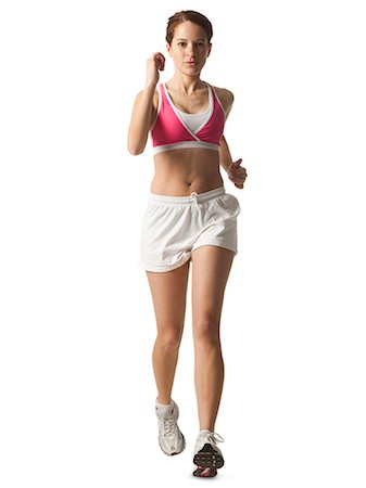 Young woman walking for exercise, studio shot Stock Photo - Premium Royalty-Free, Code: 640-03257179