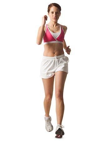 Young woman walking for exercise, studio shot Stock Photo - Premium Royalty-Free, Code: 640-03257179