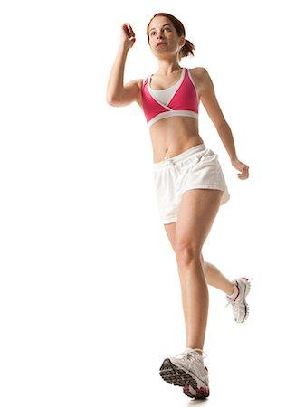 Young woman power walking, studio shot Stock Photo - Premium Royalty-Free, Code: 640-03257184