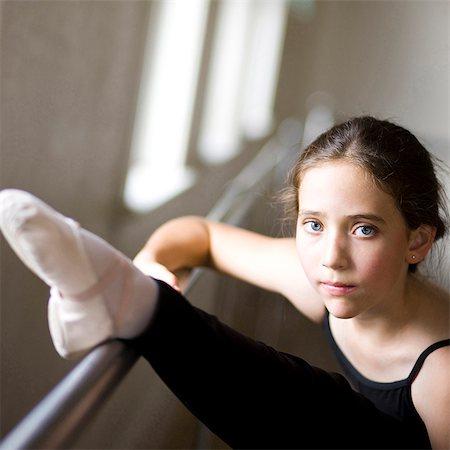 Springville, Utah, USA, Ballet dancer (12-13) stretching Stock Photo - Premium Royalty-Free, Code: 640-03257496