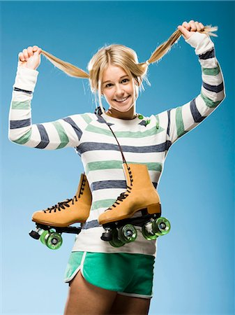 roller skate - Studio portrait of young woman with roller skates Stock Photo - Premium Royalty-Free, Code: 640-03257524