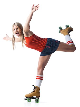 roller skate - Portrait of young woman roller skating Stock Photo - Premium Royalty-Free, Code: 640-03257534