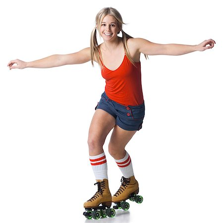roller skate - Portrait of young woman roller skating Stock Photo - Premium Royalty-Free, Code: 640-03257535