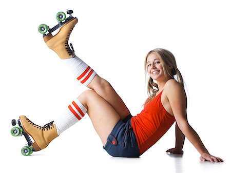 roller skate - Portrait of young woman wearing roller skates Stock Photo - Premium Royalty-Free, Code: 640-03257536