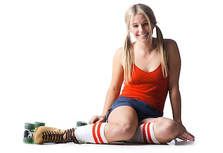 roller skate - Portrait of young woman wearing roller skates Stock Photo - Premium Royalty-Free, Code: 640-03257537