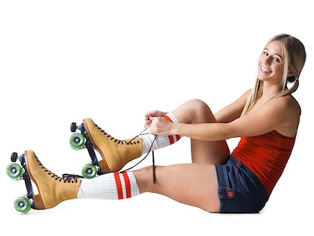 roller skate - Portrait of young woman tying roller skates Stock Photo - Premium Royalty-Free, Code: 640-03257538