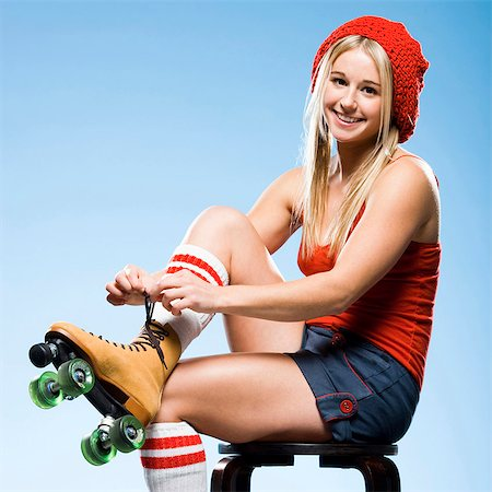 roller skate - Portrait of young woman wearing roller skates Stock Photo - Premium Royalty-Free, Code: 640-03257530