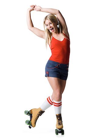 roller skate - Portrait of young woman roller skating Stock Photo - Premium Royalty-Free, Code: 640-03257532