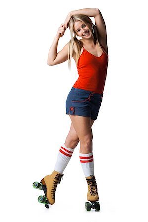 roller skate - Portrait of young woman roller skating Stock Photo - Premium Royalty-Free, Code: 640-03257533