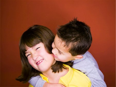 Little brother kissing older sister Stock Photo - Premium Royalty-Free, Code: 640-03258307