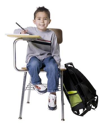 school desk - Schoolboy at desk Stock Photo - Premium Royalty-Free, Code: 640-03258315