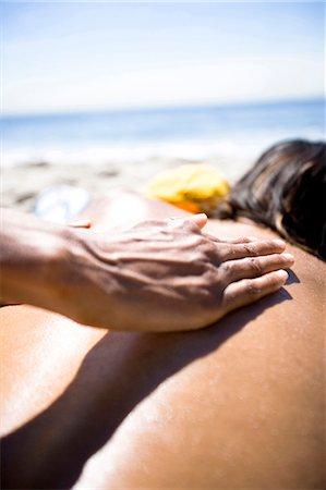 Woman applying sun screen to man Stock Photo - Premium Royalty-Free, Code: 640-03258749