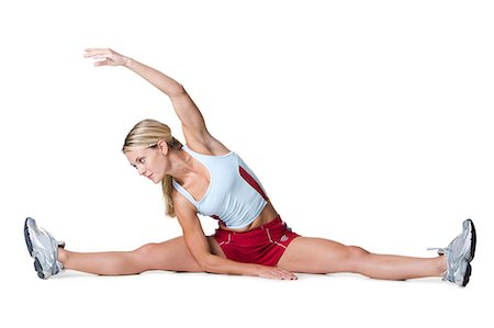 Woman stretching Stock Photo - Premium Royalty-Free, Code: 640-03259548
