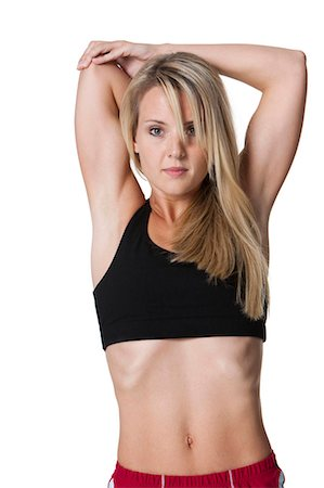 female rear end - Woman from behind stretching arms Stock Photo - Premium Royalty-Free, Code: 640-03259555
