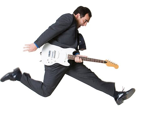 Businessman jumping with electric guitar Stock Photo - Premium Royalty-Free, Code: 640-03259600