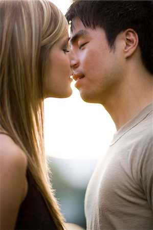 Young couple about to kiss Stock Photo - Premium Royalty-Free, Code: 640-03259852
