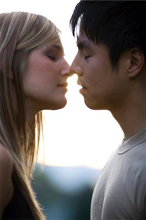 Young couple about to kiss Stock Photo - Premium Royalty-Free, Code: 640-03259853