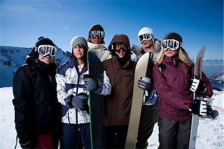 sports and snowboarding - A group of friends outside in the snow Stock Photo - Premium Royalty-Free, Code: 640-03264234