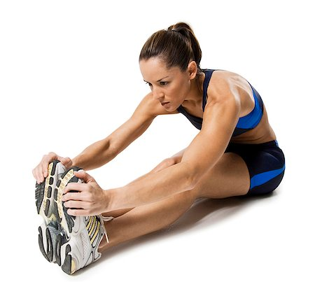 Woman athlete stretching legs Stock Photo - Premium Royalty-Free, Code: 640-03264475