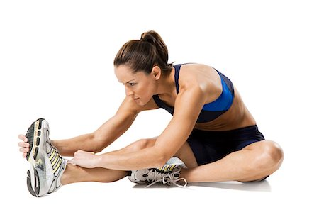 Woman athlete stretching legs Stock Photo - Premium Royalty-Free, Code: 640-03264477