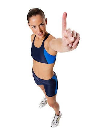 Woman athlete holding medal and making hand gesture Stock Photo - Premium Royalty-Free, Code: 640-03264483