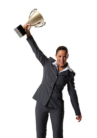 Woman holding trophy Stock Photo - Premium Royalty-Free, Code: 640-03264494