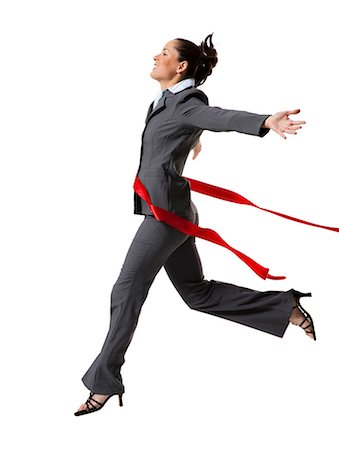 finish line - Businesswoman crossing finish line Stock Photo - Premium Royalty-Free, Code: 640-03264498