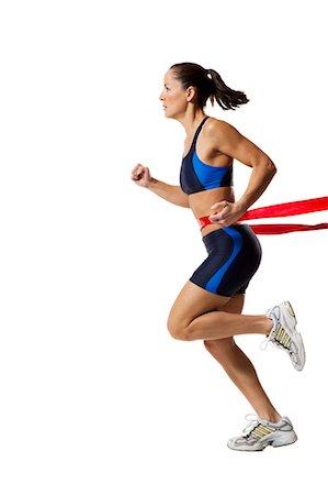 finish line - Woman athlete at the finish line Stock Photo - Premium Royalty-Free, Code: 640-03264490