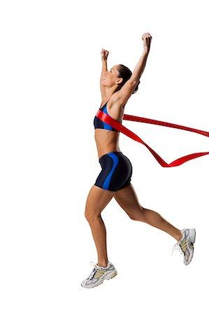finish line - Woman athlete at the finish line Stock Photo - Premium Royalty-Free, Code: 640-03264491