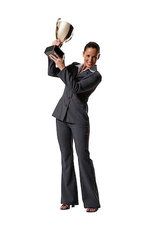 Woman holding trophy Stock Photo - Premium Royalty-Free, Code: 640-03264492