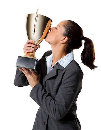 Woman holding trophy Stock Photo - Premium Royalty-Free, Code: 640-03264493